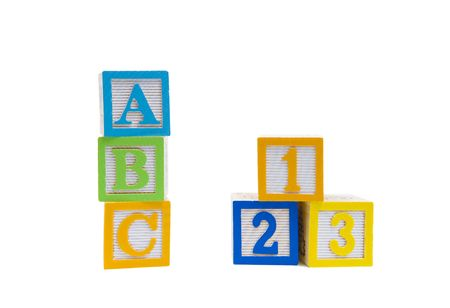 ABC 123 spelled out in wooden blocks isolated on a white background Imagens