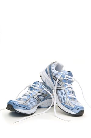 shoe laces: Pair of running shoes on a white background Stock Photo