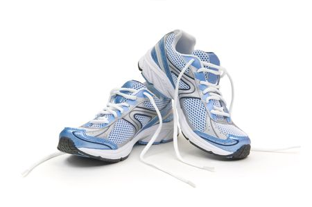 shoe laces: Pair of running shoes on a white background