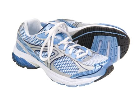 running shoes: Pair of blue running shoes isolated on a whitebackground with path. Stock Photo
