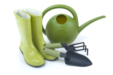 Gardening boots and tools on a white background