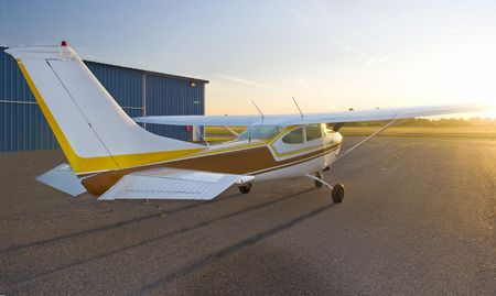 aeronautical: Single engine airplane getting ready for a sunrise take-off