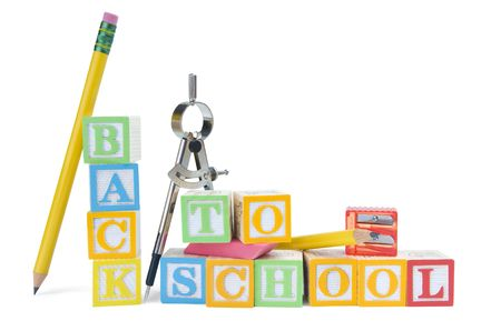 Back to school written in wooden blocks with school supplies on a white background. Clipping included.