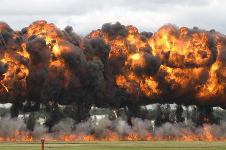 Close-up of  napalm bombs exploding in a field Stock fotó - 5448135