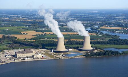 fission: Aerial view of a nuclear power plant along the shoreline