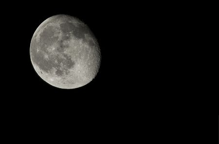 three phase: Moon shot at three quarters full on a dark night