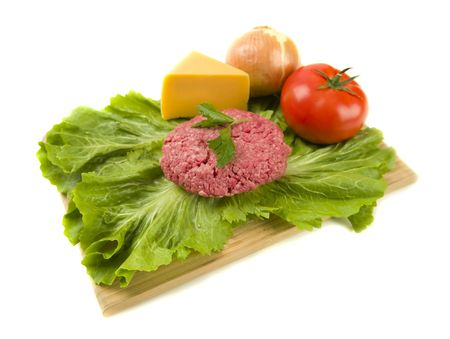 Raw hamburger with toppings on a white background