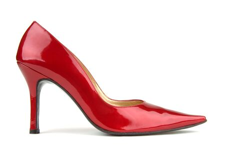 Single red patent leather shoe on a white background