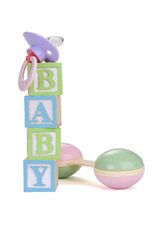 pacifier: The word baby written in blocks with toys
