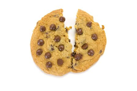 Broken chocolate chip cookie on a white background
