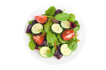 A fresh garden salad on a white plate isolated on a white background Imagens