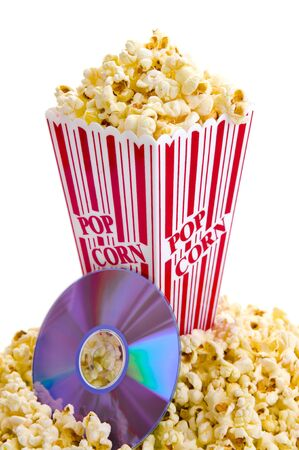 Home movie night concept with a bucket of popcorn and a DVD