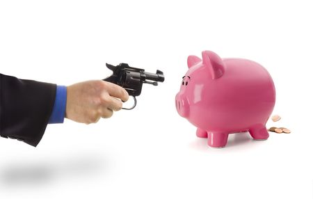 A banker scaring the pennies out of piggy bank photo