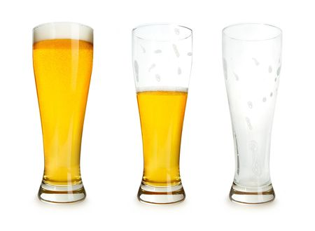 half: Three glasses of beer with one full, one half gone, and one empty on a white background.