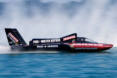 DETROIT - JULY 9 2010: The Jarvis hydroplane races along the river at the APBA Gold Cup July 9, 2010 on the Detroit River in Detroit, Michigan.