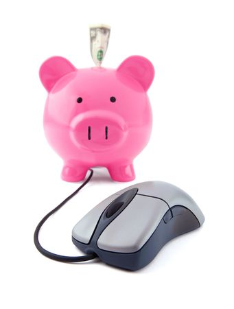 Internet business concept with a mouse and a piggy bank on a white background with focus on the mouse. photo