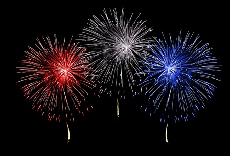 Red white and blue fireworks on a black background