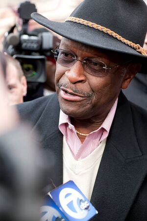 herman: YPSILANTI, MI - NOVEMBER 10th: Republican Presidential candidate Herman Cain answers reporters questions outside of Big Sky Diner, November 10, 2011 in Ypsilanti, MI