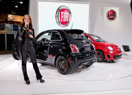 DETROIT - JANUARY 11: A spokesmodel talks about the 2013 Fiat Abarth at the 2012 North American International Auto Show Industry Preview on January 11, 2012 in Detroit, Michigan.