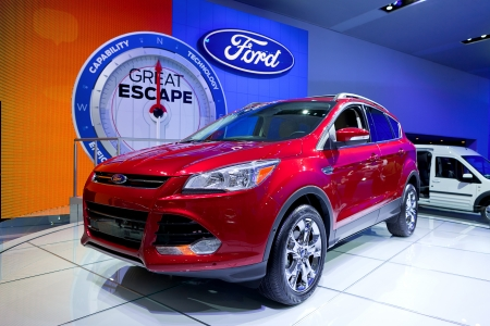 DETROIT - JANUARY 11: The 2013 Ford Escape Hybrid at the 2012 North American International Auto Show Industry Preview on January 11, 2012 in Detroit, Michigan.  Stock Photo - 11987530