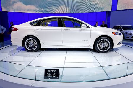 DETROIT - JANUARY 11: The 2013 Ford Fusion SE sedan at the 2012 North American International Auto Show Industry Preview on January 11, 2012 in Detroit, Michigan.