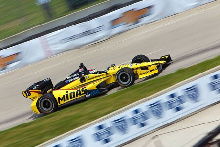 DETROIT - MAY 31: The Midas Indy car races by at the Detroit Grand Prix May 31, 2013 in Detroit, Michigan.