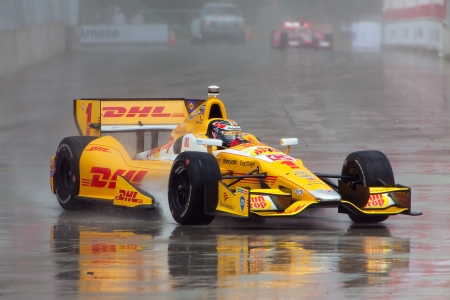 indy: DETROIT - MAY 31: The Sun Drop Indy race car rounds a corner in the rain at the Detroit Grand Prix May 31, 2013 in Detroit, Michigan.