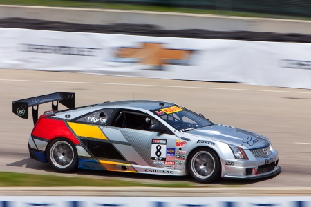 pirelli: DETROIT - MAY 31: The Pirelli Series Cadillac races by at the Detroit Grand Prix May 31, 2013 in Detroit, Michigan. Editorial