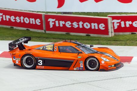 corvette: DETROIT - MAY 31: A Chevrolet Corvette rounds a corner at the Detroit Grand Prix May 31, 2013 in Detroit, Michigan.