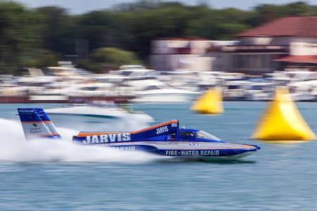 hydroplane: DETROIT - JULY 12 : The Jarvis hydroplane races past the Detroit Yacht Club at the APBA Gold Cup July 14, 2012 on the Detroit River in Detroit, Michigan.
