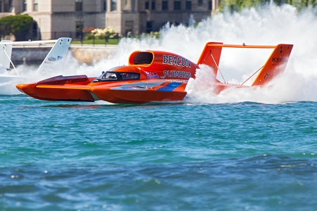 hydroplane: DETROIT - JULY 13: j Michael kelly pilots the Beacon Plumbing hydroplane at the APBA Gold Cup July 13, 2013 on the Detroit River in Detroit, Michigan. Editorial