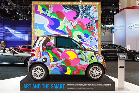 CHICAGO - FEBRUARY 6 : A Smart car wrapped in graffiti artwork by Miguel Paredes on display at the Chicago Auto Show media preview February 6, 2014 in Chicago, Illinois.