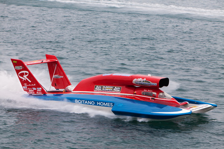 hydroplane: DETROIT - JULY 12: Mike Webster in the U-22 hydroplane at the APBA Gold Cup July 12, 2014 on the Detroit River in Detroit, Michigan.