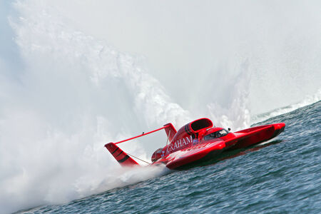 DETROIT - JULY 13: The Graham Trucking hydroplane speeds by at the APBA Gold Cup July 13, 2014 on the Detroit River in Detroit, Michigan.