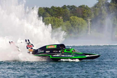 hydroplane: DETROIT - JULY 11: The Miss DiJulio hydroplane at the APBA Gold Cup July 11, 2014 on the Detroit River in Detroit, Michigan.
