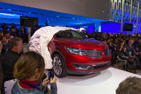 sport utility vehicle: DETROIT - JANUARY 13: The Lincoln MKX luxury sport utility vehicle is unveiled on January 13th, 2015 at the 2015 North American International Auto Show in Detroit, Michigan.