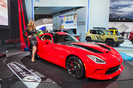 DETROIT - JANUARY 13: A show model poses with the Dodge Viper  January 13th, 2015 at the 2015 North American International Auto Show in Detroit, Michigan. Editorial