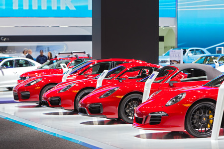 DETROIT - JANUARY 15: A row of Porsches on display January 13th, 2015 at the 2015 North American International Auto Show in Detroit, Michigan.