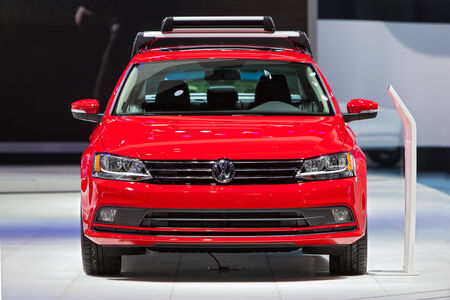 car front: DETROIT - JANUARY 13: A Volkswagen Jetta on display January 13th, 2015 at the 2015 North American International Auto Show in Detroit, Michigan. Editorial