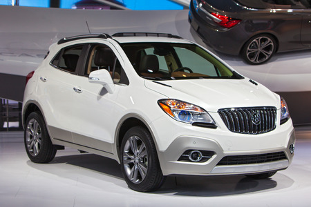 enclave: DETROIT - JANUARY 15: A Buick Enclave SUV on display January 15th, 2015 at the 2015 North American International Auto Show in Detroit, Michigan.