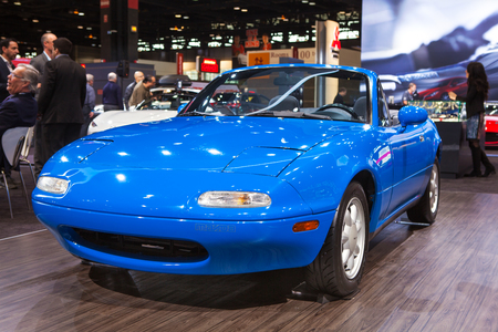 american media: Chicago - February 13: A 1990 Mazda Miata on display February 13th, 2015 at the 2015 Chicago Auto Show in Chicago, Illinois.