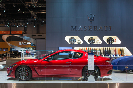 Chicago - February 12: A Maserati Granturismo sits under cover February 12th, 2015 at the 2015 Chicago Auto Show in Chicago, Illinois.