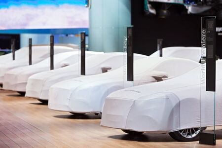 unveil: DETROIT - JANUARY 13: A row of covered Mercedes Benz at the North American International Auto Show media preview January 13, 2016 in Detroit, Michigan.