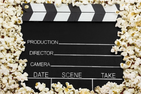 Clapboard with pop corns photo