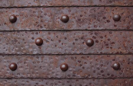 Fragment of a metal shod door with round rivets Stock Photo - 6380606