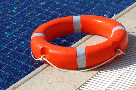 brink: Life buoy on the brink of  swimming pool