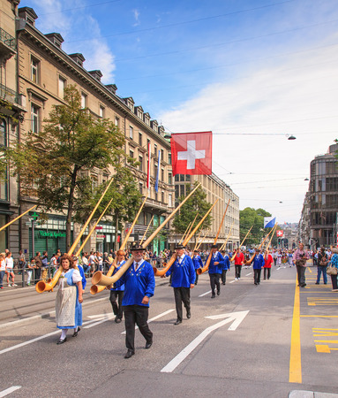 alphorn: Zurich, Switzerland - 1 August, 2014  the traditional Swiss National Day parade passes the Bahnhofstrasse street  The Swiss National Day  German  Schweizer Bundesfeier  is the national holiday of Switzerland, set on 1 August