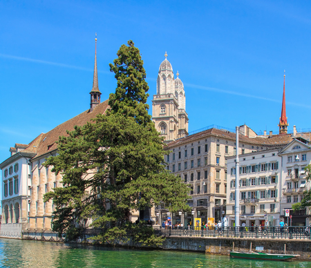grossmunster cathedral: Zurich, Switzerland - 3 July, 2014: cityscape with the Water Church and the Grossmunster Cathedral. Zurich is the largest city in Switzerland and the capital of the Canton of Zurich. Editorial
