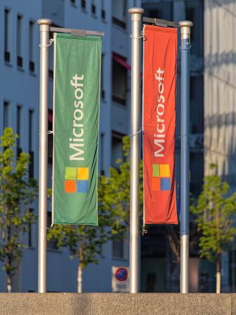microsoft: Wallisellen Switzerland  2 June 2015: flags with Microsoft Windows logotype installed on the crossing of the Industriestrasse and Richtistrasse streets near Microsoft Switzerland Ltd office.