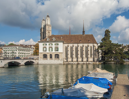 grossmunster cathedral: Zurich, Switzerland - 1 October, 2014: view on the Grossmunster cathedral and the Limmatquai quay across the Limmat river. Zurich is the largest city in Switzerland and the capital of the Canton of Zurich. Editorial